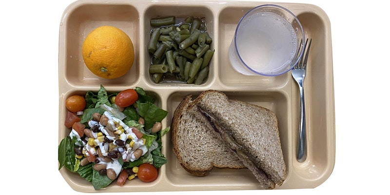 reusable school lunch tray with food in each compartment plus reusable glass and fork